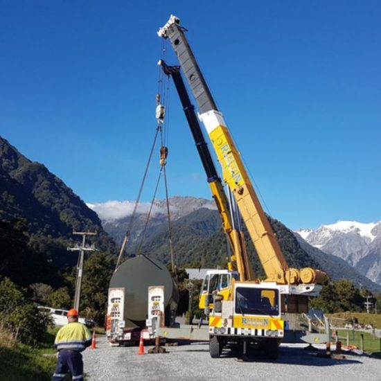 SuperVault lifted into position by crane at Franz Josef Heli Pad