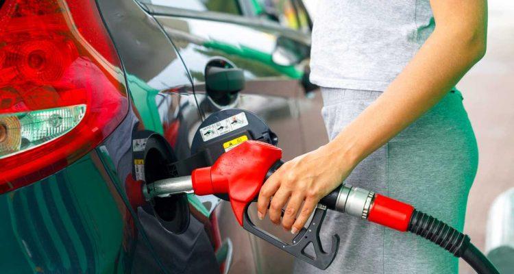 Woman filling car at petrol station